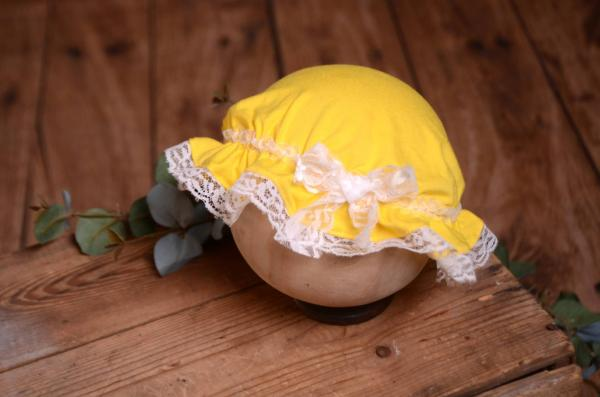 Yellow and white bath hat for babies