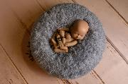 Multiposition puff with bluish grey cover with feathers