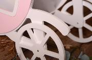 Carroza rosa y blanco