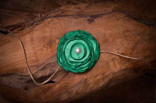 Diadema con flor verde oscuro