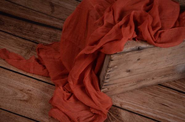 Dark orange muslin wrap