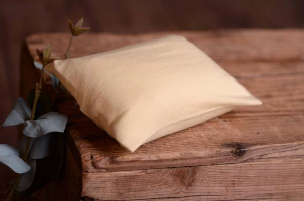 Mini pillow with light beige cover