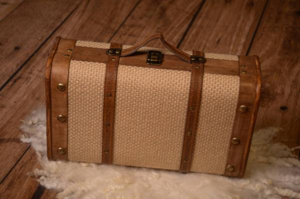 Small beige suitcase