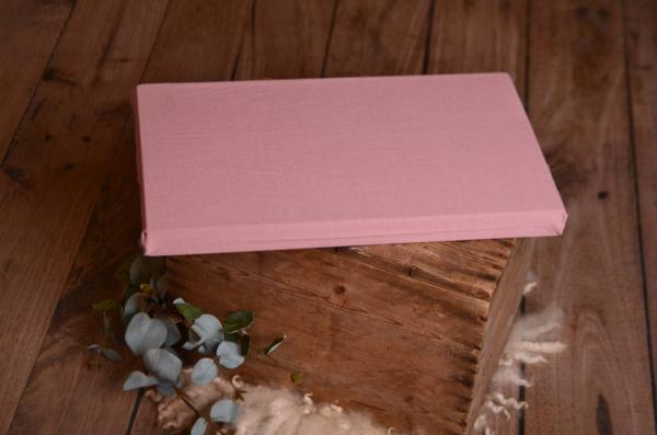 Mattress with dark pink cover