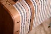 Small blue and white suitcase