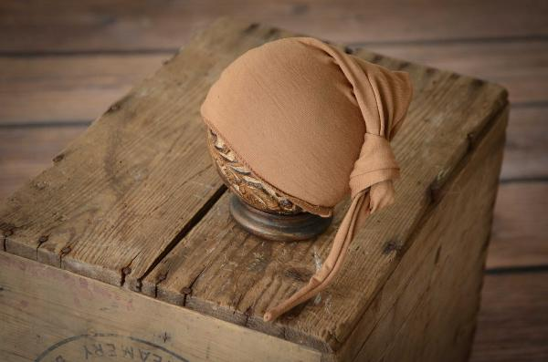 Light brown long stitch hat with knot