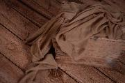 Light brown muslin wrap