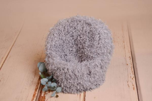 Bluish grey armchair cover with feathers