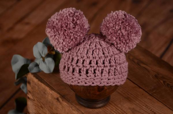 Pink hat with pompoms
