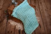 Light blue plaited blanket