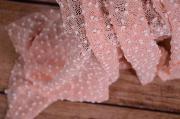 Pink tasseled wrap