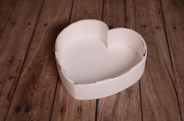 Damaged white heart-shaped rustic bowl