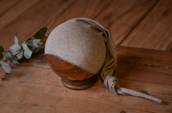 Grey long stitch hat with knot