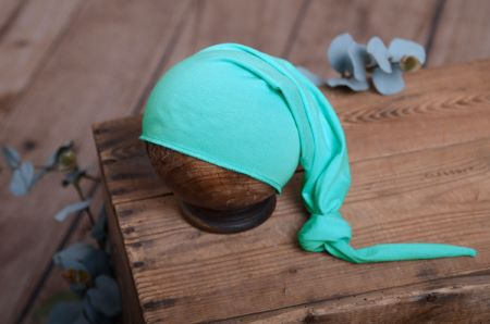Strickmütze mit Knoten in Aquagrün