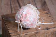 Capota bebé de tela beige y rosa