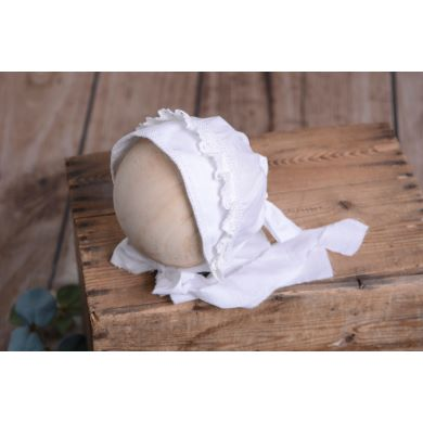 White fabric bonnet for baby