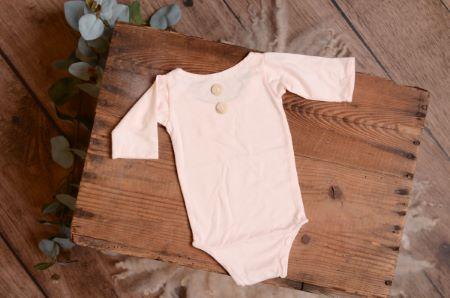 Body de punto con mangas rosa bebé