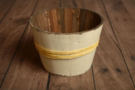 Damaged white small rustic bucket