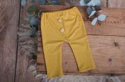 Pack de pantalón y gorro largo de punto con nudo mostaza