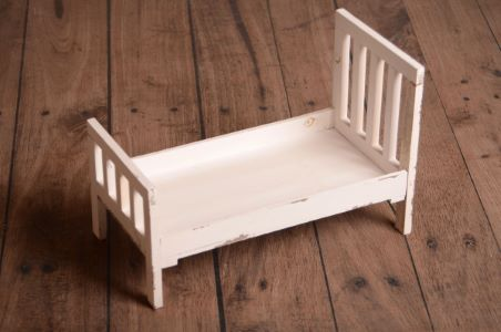 Damged off-white straight headboard rustic bed