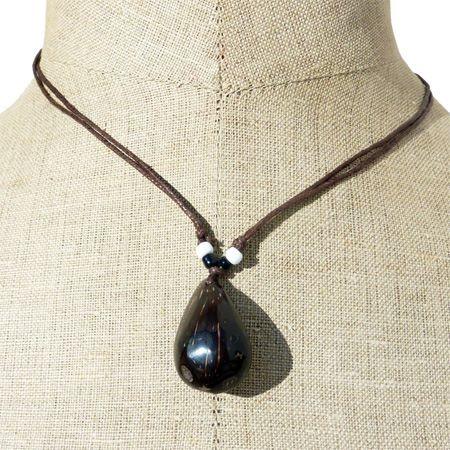 collier pendentif graine de palmier artisant balinais