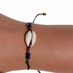 Bracelet cauris sur cordon perles à facettes bleues et rocailles bronzes