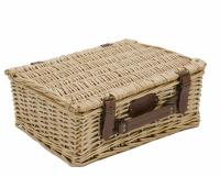 Empty wicker basket with cream fabric