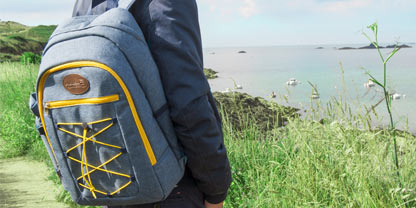 backpack for picnic in front of the sea