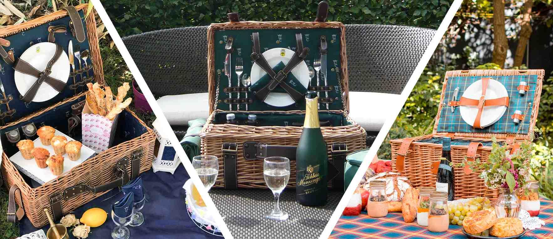 panier pique-nique de luxe en osier et en cuir sur une table de jardin